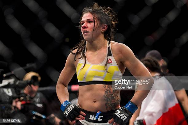 Claudia Gadelha stands in the Octagon before the decision during The Ultimate Fighter Finale at MGM Grand Garden Arena on July 8 2016 in Las Vegas...