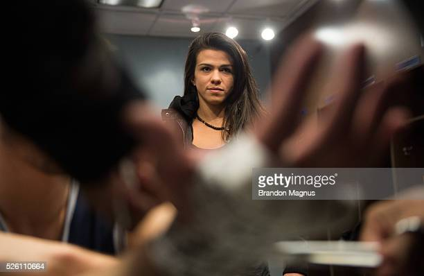 Claudia Gadelha watches as Corey Hendricks gets his hands wrapped before facing Khalill Rountree during the filming of The Ultimate Fighter Team...