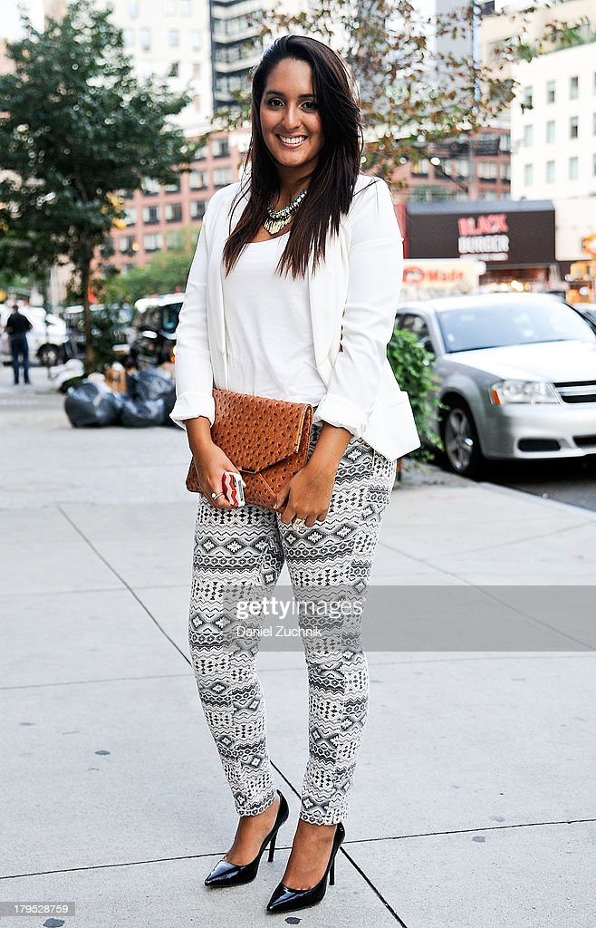 Claudia Garcia is seen outside the Pamela Gonzales presentation wearing Charlotte Russe pants, H&M blazer, BCBG heels and an H&M necklace on September 4, 2013 in New York City.