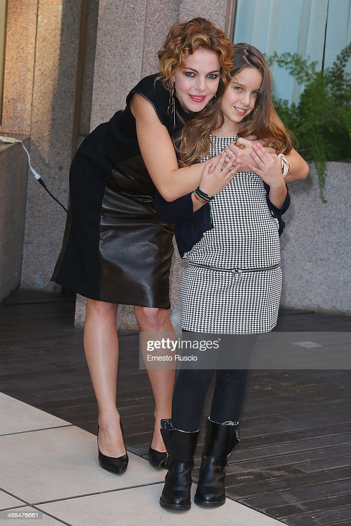 (L-R9 <a gi-track='captionPersonalityLinkClicked' href=/galleries/search?phrase=Claudia+Gerini&family=editorial&specificpeople=220347 ng-click='$event.stopPropagation()'>Claudia Gerini</a> and her daugther Rosa Enginoli attend the 'Indovina Chi Viene A Natale' Photocall at Hotel Visconti on December 12, 2013 in Rome, Italy.