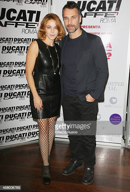 Claudia Gerini and Raul Bova attend the 'Indovina Chi Viene A Natale' party at Ducati Caffe on December 19 2013 in Rome Italy