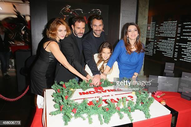 Claudia Gerini Fausto Brizzi Rosa Enginoli Raul Bova and Rosalia Porcaro attend the 'Indovina Chi Viene A Natale' party at Ducati Caffe on December...
