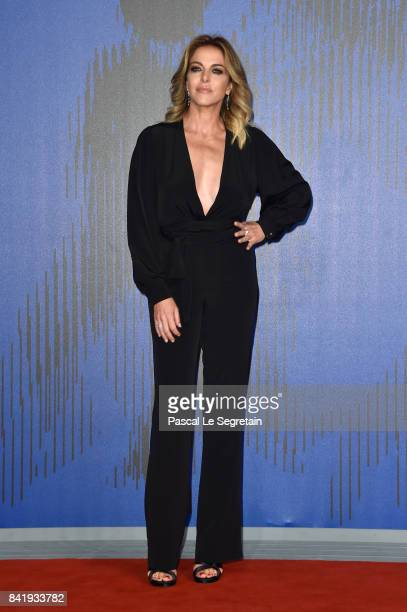 Claudia Gerini walks the red carpet ahead of the 'Suburra La Serie' screening during the 74th Venice Film Festival at Sala Giardino on September 2...