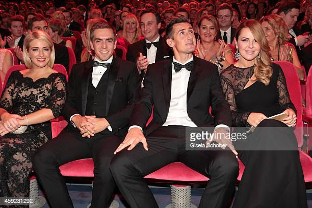 Claudia Lahm Philipp Lahm Mirsolav Klose and Sylwia Klose arrive at the Bambi Awards 2014 on November 13 2014 in Berlin Germany