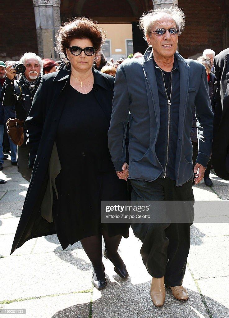 Claudia Mori and Adriano Celentano attend the funeral of Singer Enzo Jannacci at Basilica di Sant'Ambrogio on April 2 2013 in Milan Italy