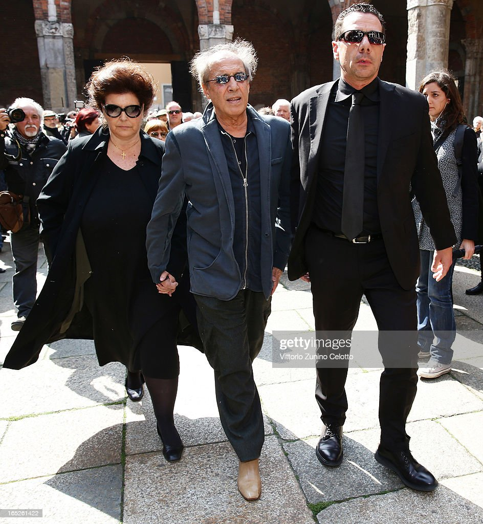 Claudia Mori and Adriano Celentano attend the funeral of Singer Enzo Jannacci at Basilica di Sant'Ambrogio on April 2, 2013 in Milan, Italy.