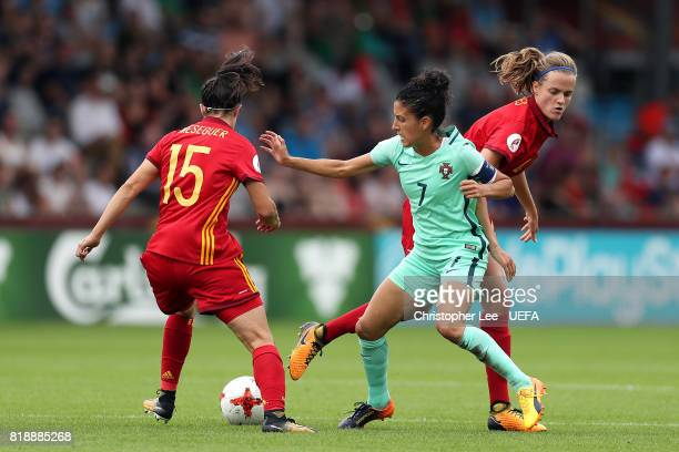 Claudia Neto of Portugal tries to hold off Irene Paredes and Silvia Meseguer of Spain during the UEFA Women's Euro 2017 Group D match between Spain...