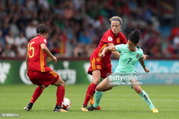 Claudia Neto of Portugal tries to hold off Irene Paredes of Spain and Silvia Meseguer of Spain during the UEFA Women's Euro 2017 Group D match...