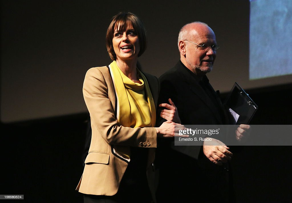 Claudia Pandolfi on stage with Festival Director Marco Mueller after she won the Lancia 2012 Elegance In Motion award during the Collateral Awards Ceremony at the 7th Rome Film Festival at the Auditorium Parco Della Musica on November 17, 2012 in Rome, Italy.