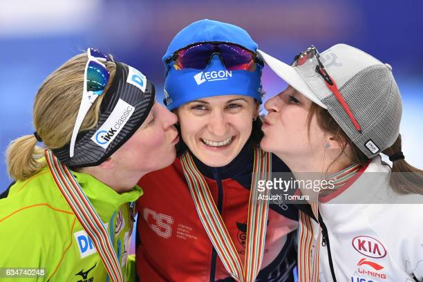 Claudia Pechstein of Germany Martina Sablikova of Czech Republic and Ivanie Blondin of Canada pose with their medals for the ladies 5000m during the...