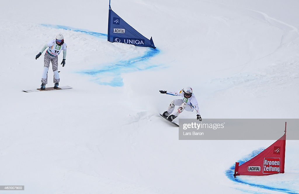 <a gi-track='captionPersonalityLinkClicked' href=/galleries/search?phrase=Claudia+Riegler+-+Austrian+Snowboarder+-+Born+1973&family=editorial&specificpeople=12458153 ng-click='$event.stopPropagation()'>Claudia Riegler</a> of Austria (R) wins gold as <a gi-track='captionPersonalityLinkClicked' href=/galleries/search?phrase=Alena+Zavarzina&family=editorial&specificpeople=6598104 ng-click='$event.stopPropagation()'>Alena Zavarzina</a> (L) of Russia misses a gate in the Women's Parallel Giant Slalom Finals during the FIS Freestyle Ski and Snowboard World Championships 2015 on January 23, 2015 in Lachtal, Austria.