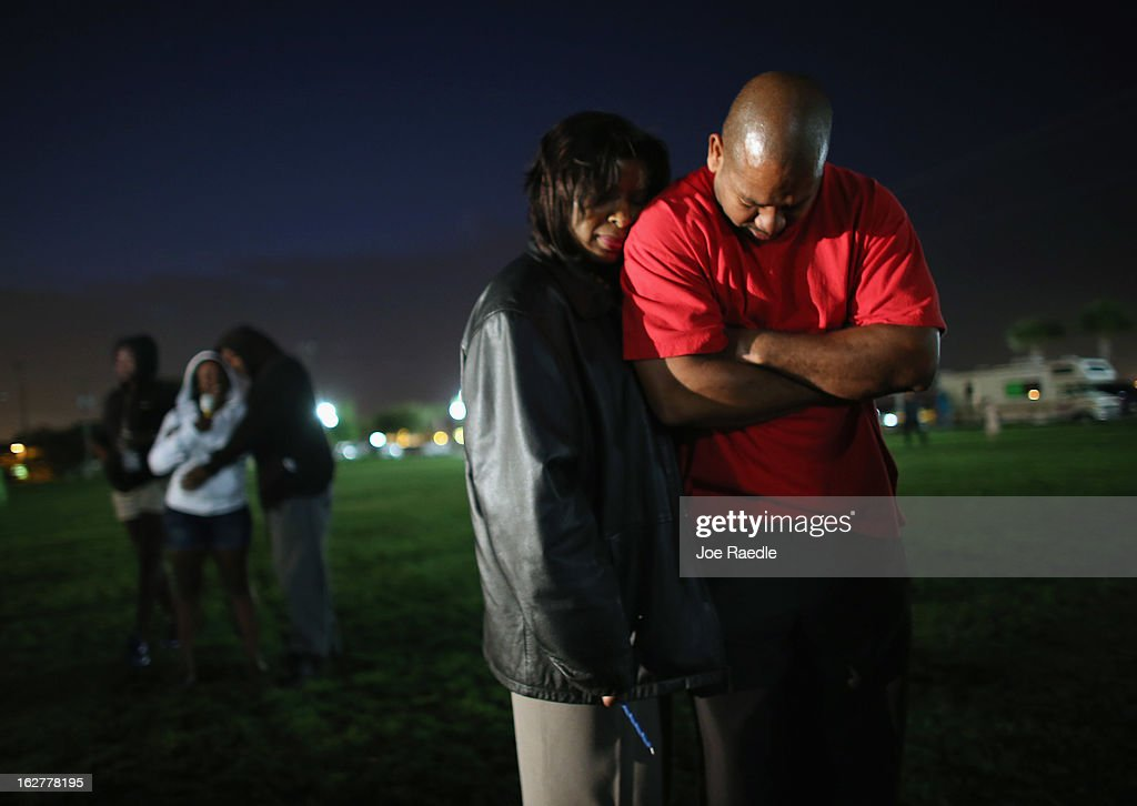 Claudia Robinson and Otis Robinson (L-R) stand together during a prayer before lighting candles during a vigil at Fort Mellon Park to mark the one year anniversary of when Trayvon Martin was killed on February 26, 2013 in Sanford, Florida. Martin was shot by George Zimmerman on February 26, 2012 while Zimmerman was on neighborhood watch patrol in the gated community of The Retreat at Twin Lakes in Sanford, Florida.