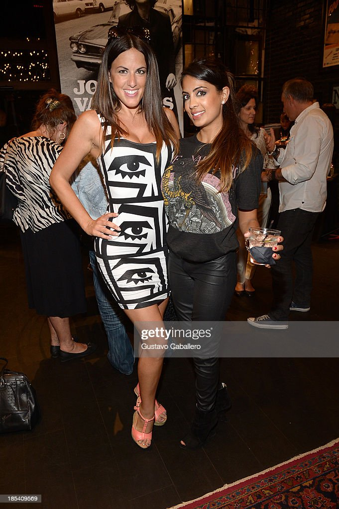 Claudia Romani and Sunita Bhagwan attends the Rock in Fashion Book Launch at John Varvatos South Beach Miami on October 19, 2013 in Miami, Florida.