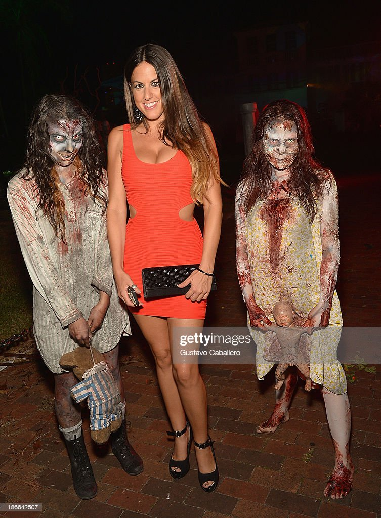 Claudia Romani attends Lisa Hochstein of 'Real Housewives of Miami' and Lenny Hochstein's Halloween Ball benefitting the Make-A-Wish Foundation on November 1, 2013 in Miami Beach, Florida.