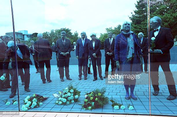 Claudia Roth vice president of the German Bundestag looks at a blue glass monument dedicated to the over 200000 victims of the euthanasia program...
