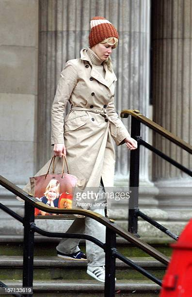 Claudia Schiffer In London Carrying An 'Anya Hindmarch' Designer Bag Which Features A Photograph Of Her As A Girl
