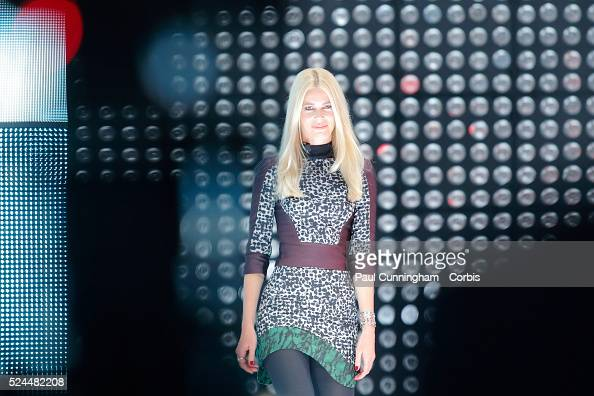 Claudia Schiffer is a star guest at the Opel / Vauxhall Corsa stand during Press day at the Paris Auto Show 2014 2 October 2014 Image by �� Paul...