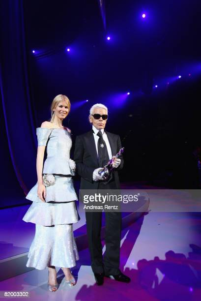 Claudia Schiffer presents Karl Lagerfeld with a 'Platinum' lifetime achievement award at the ELLE Fashion Star award ceremony during Mercedes Benz...