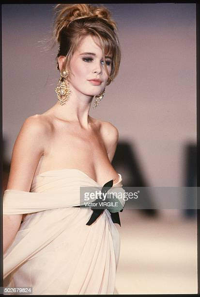 Claudia Schiffer walks the runway during the Chanel Haute Couture show as part of Paris Fashion Week Spring/Summer 19901991 in January 1990 in Paris...