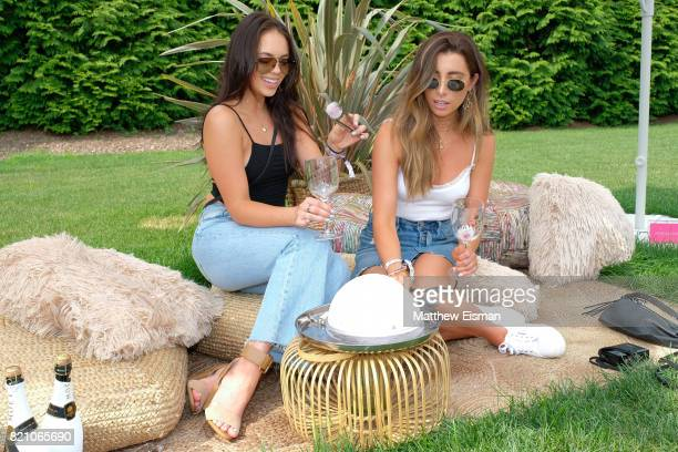 Claudia Sulewski and Lauren Elizabeth celebrate #REVOLVEintheHamptons Close Out Party with Moet Chandon on July 22 2017 in Bridgehampton New York