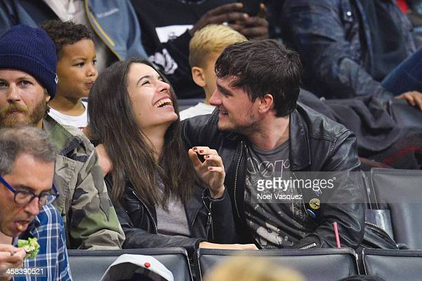 Claudia Traisac and Josh Hutcherson attend a basketball game between the Toronto Raptors and the Los Angeles Clippers at Staples Center on November...