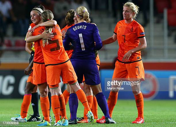 Claudia van den Heiligenberg of Netherlands celebrate with team mate Anouk Hoogendijk after the UEFA Women's Euro 2013 group B match at Vaxjo Arena...