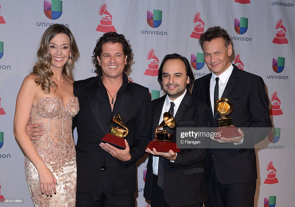 Claudia Vasquez, Singer <a gi-track='captionPersonalityLinkClicked' href=/galleries/search?phrase=Carlos+Vives&family=editorial&specificpeople=235771 ng-click='$event.stopPropagation()'>Carlos Vives</a> and Andres Castro pose backstage at the 14th Annual Latin GRAMMY Awards at Mandalay Bay Events Center on November 21, 2013 in Las Vegas, Nevada.