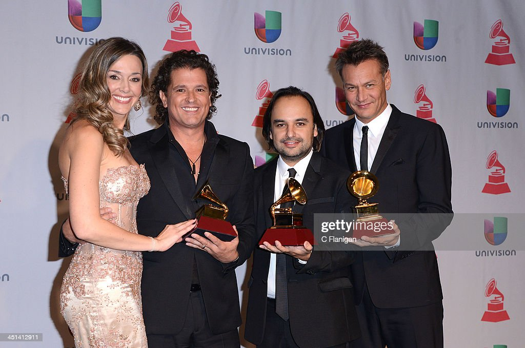 Claudia Vasquez, Singer Carlos Vives and Andres Castro pose backstage at the 14th Annual Latin GRAMMY Awards at Mandalay Bay Events Center on November 21, 2013 in Las Vegas, Nevada.
