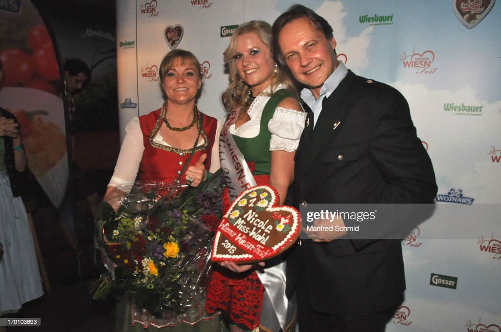 Claudia Wiesner, Nicole and Christian Feldhofer pose during the beauty competition 'Miss Wiener Wiesn-Fest 2013' at Bettel-Alm on June 6, 2013 in Vienna, Austria.