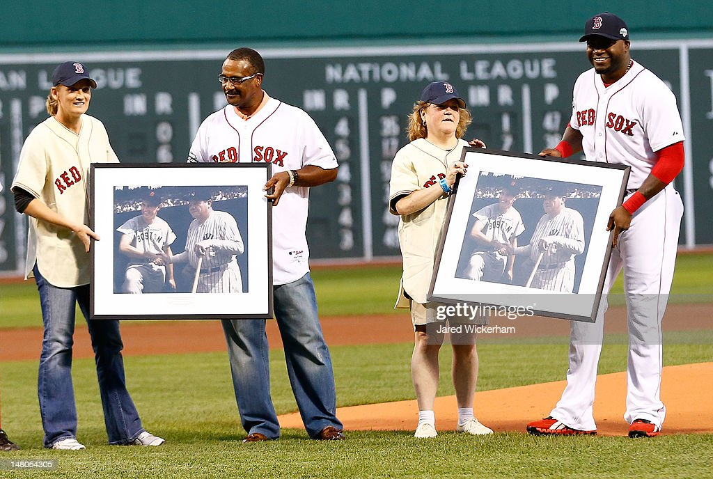 Claudia Williams, far left, daughter of former Boston Red Sox player Ted Williams, and Linda Ruth Tosetti, right, granddaughter of former New York Yankees player Babe Ruth, are presented with a framed plaque from <a gi-track='captionPersonalityLinkClicked' href=/galleries/search?phrase=David+Ortiz&family=editorial&specificpeople=175825 ng-click='$event.stopPropagation()'>David Ortiz</a> #34 and former Red Sox player <a gi-track='captionPersonalityLinkClicked' href=/galleries/search?phrase=Jim+Rice&family=editorial&specificpeople=220917 ng-click='$event.stopPropagation()'>Jim Rice</a> prior to the game between the Boston Red Sox and the New York Yankees on July 8, 2012 at Fenway Park in Boston, Massachusetts.
