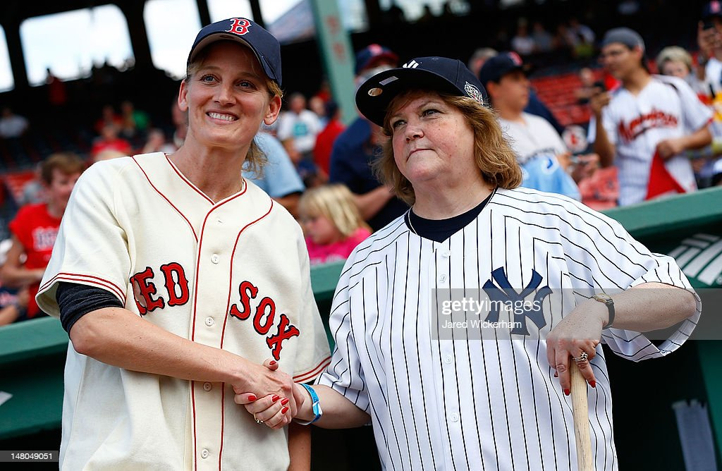 Claudia Williams, left, daughter of former Boston Red Sox player Ted Williams, poses for a portrait with Linda Ruth Tosetti, right, granddaughter of former New York Yankees player Babe Ruth, prior to the game between the Boston Red Sox and the New York Yankees during on July 8, 2012 at Fenway Park in Boston, Massachusetts.