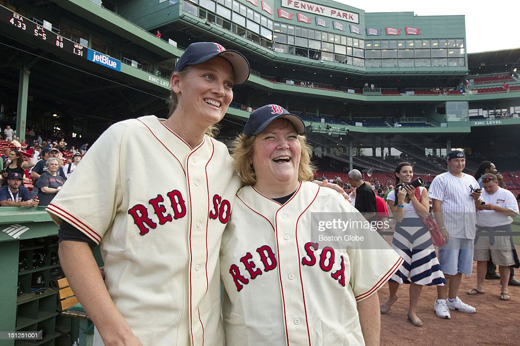 Claudia Williams, left, daughter of Ted Williams, and Linda Ruth Tosetti, granddaughter of Babe Ruth, pose for a picture before the Boston Red Sox play the New York Yankees at Fenway Park on Sunday, July 8, 2012. Tosetti and Williams threw out the ceremonial first pitch.