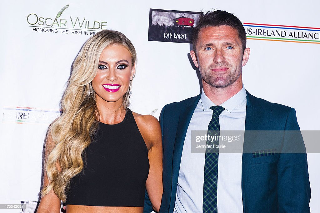 Claudine Keane and football player <a gi-track='captionPersonalityLinkClicked' href=/galleries/search?phrase=Robbie+Keane&family=editorial&specificpeople=171824 ng-click='$event.stopPropagation()'>Robbie Keane</a> attend the 9th Annual 'Oscar Wilde: Honoring The Irish In Film' Pre-Academy Awards event at Bad Robot on February 27, 2014 in Santa Monica, California.