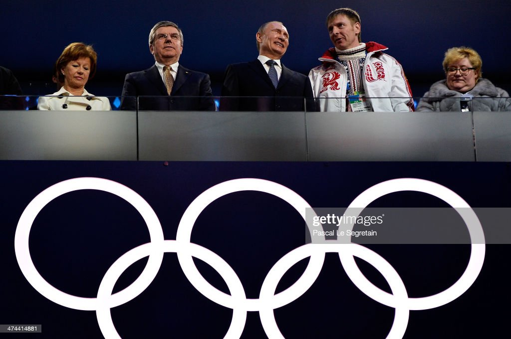 Claudio Bach, <a gi-track='captionPersonalityLinkClicked' href=/galleries/search?phrase=Thomas+Bach&family=editorial&specificpeople=610149 ng-click='$event.stopPropagation()'>Thomas Bach</a>, President of the IOC, Russian President <a gi-track='captionPersonalityLinkClicked' href=/galleries/search?phrase=Vladimir+Putin&family=editorial&specificpeople=154896 ng-click='$event.stopPropagation()'>Vladimir Putin</a> and Russian Bobsleigh pilot Alexander Zubkov attend the 2014 Sochi Winter Olympics Closing Ceremony at Fisht Olympic Stadium on February 23, 2014 in Sochi, Russia.