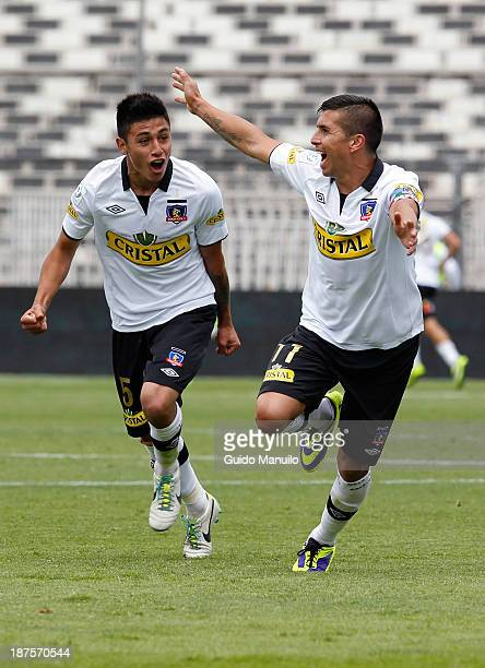 Claudio Baeza and Gonzalo Fierro of Colo Colo celebrate a scored goal aginst U de Chile during a match between Colo Colo and U de Chile as part of...
