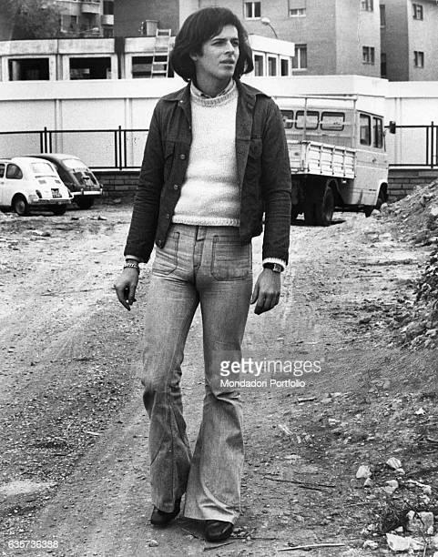 Claudio Baglioni the Italian singersongwriter walking along an unpaved road Rome 1974