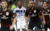 Claudio Beauvue of Lyon and Alex Rodrigo Dias da Costa of AC Milan in action during the friendly match between Olympique Lyonnais and AC Milan at...