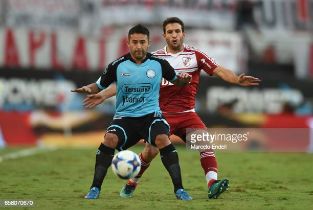 Claudio Bieber of Belgrano fights for ball with Camilo Mayada of River Plate during a match between River Plate and Belgrano as part of Torneo...