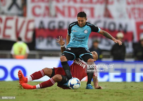 Claudio Bieber of Belgrano fights for ball with Jonathan Maidana of River Plate during a match between River Plate and Belgrano as part of Torneo...