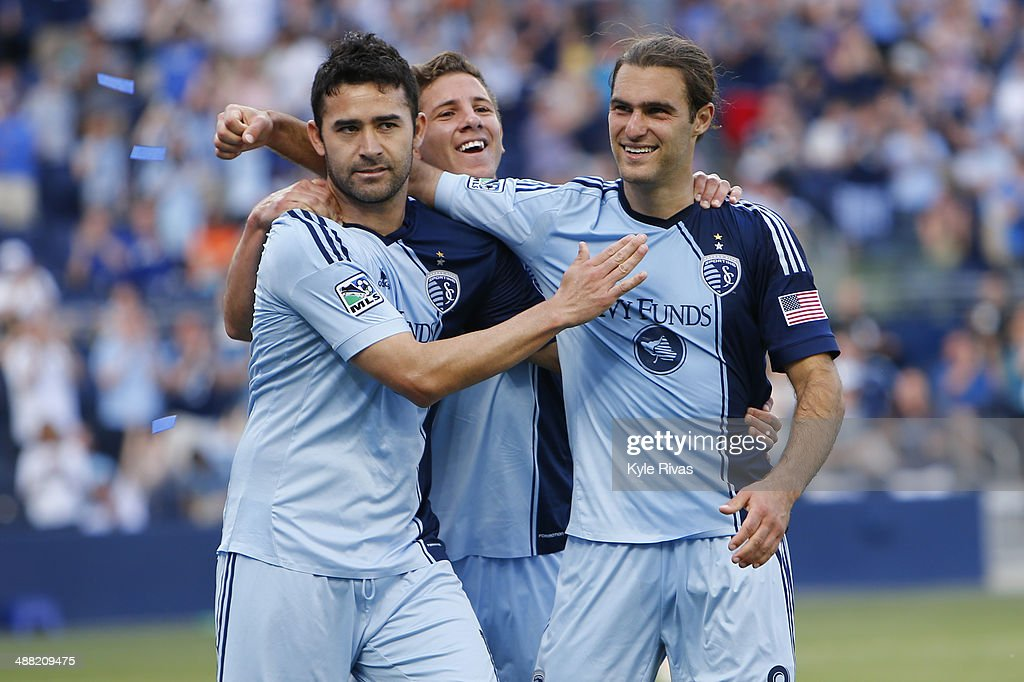 Claudio Bieler #16, Ike Opara #3 and <a gi-track='captionPersonalityLinkClicked' href=/galleries/search?phrase=Graham+Zusi&family=editorial&specificpeople=5639989 ng-click='$event.stopPropagation()'>Graham Zusi</a> #8 of Sporting KC celebrate after Bieler scored the second goal of the game on May 4, 2014 at Sporting Park in Kansas City, Kansas.