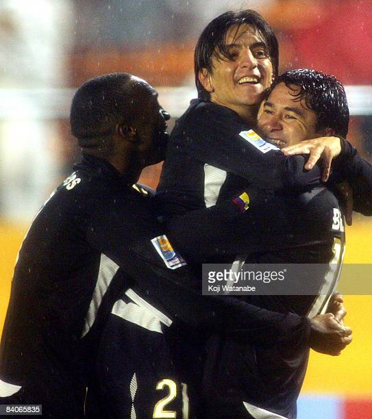 Claudio Bieler of Liga de Quito celebrates after scoring with his teammates during FIFA Club World Cup Japan 2008 semi final match between Pachuca...
