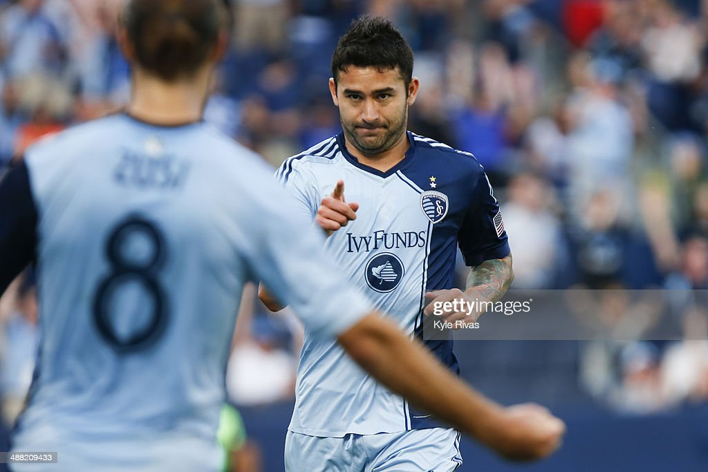 Claudio Bieler #16 of Sporting KC, after scoring the second goal of the game, acknowledges teammate <a gi-track='captionPersonalityLinkClicked' href=/galleries/search?phrase=Graham+Zusi&family=editorial&specificpeople=5639989 ng-click='$event.stopPropagation()'>Graham Zusi</a> #8 on May 4, 2014 at Sporting Park in Kansas City, Kansas.