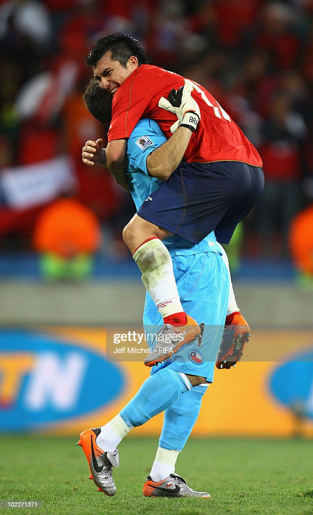 Claudio Bravo (L) and Gary Medel of Chile celebrate their victory after the 2010 FIFA World Cup South Africa Group H match between Chile and Switzerland at Nelson Mandela Bay Stadium on June 21, 2010 in Port Elizabeth, South Africa.