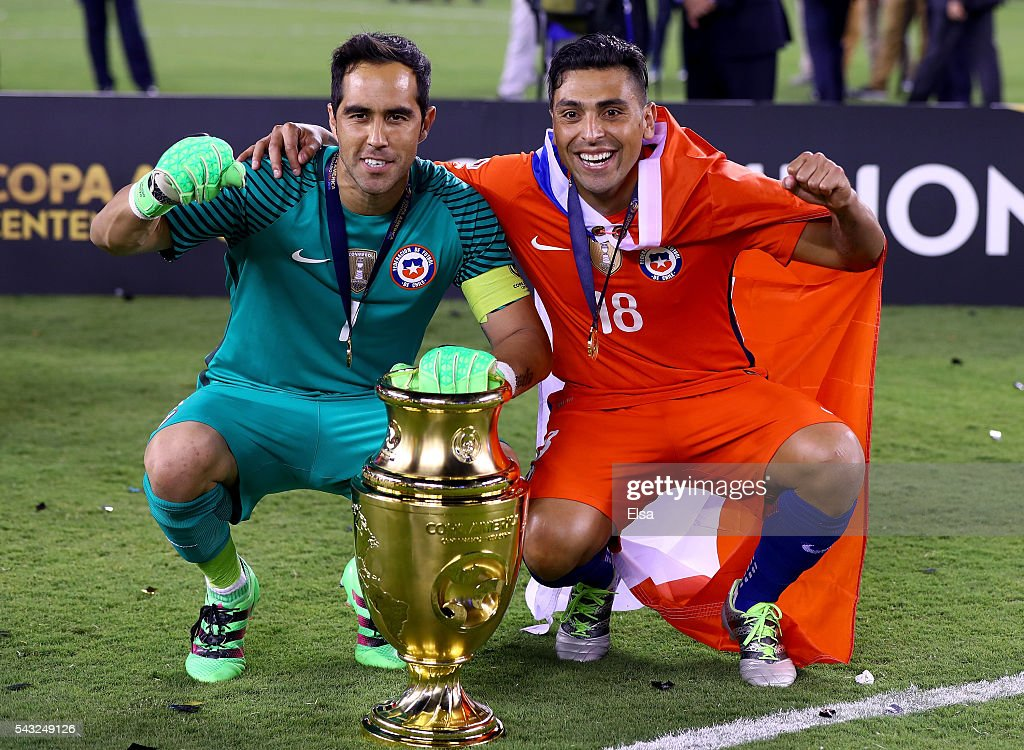 <a gi-track='captionPersonalityLinkClicked' href=/galleries/search?phrase=Claudio+Bravo&family=editorial&specificpeople=2715784 ng-click='$event.stopPropagation()'>Claudio Bravo</a> #1 and <a gi-track='captionPersonalityLinkClicked' href=/galleries/search?phrase=Gonzalo+Jara&family=editorial&specificpeople=860125 ng-click='$event.stopPropagation()'>Gonzalo Jara</a> #18 of Chile celebrate after they won the Copa America Centenario Championship match against Argentina at MetLife Stadium on June 26, 2016 in East Rutherford, New Jersey.Chile defeated Argentina 0-0 with the 4-2 win in the shootout.