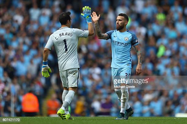 Claudio Bravo and Nicolas Otamendi of Manchester City celebrate the fourth goal during the Premier League match between Manchester City and AFC...