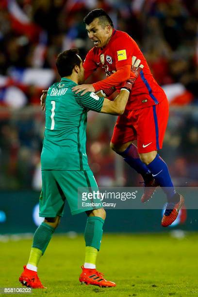 Claudio Bravo goalkeeper and Gary Medel of Chile celebrate after a match between Chile and Ecuador as part of FIFA 2018 World Cup Qualifiers at...