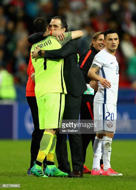 Claudio Bravo of Chile and Juan Antonio Pizzi of Chile celebrate after the FIFA Confederations Cup Russia 2017 SemiFinal between Portugal and Chile...