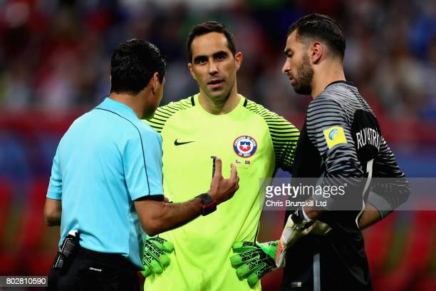 Claudio Bravo of Chile and Rui Patricio of Portugal talk to referee Alireza Faghani before the penalty shoot out during the FIFA Confederations Cup...