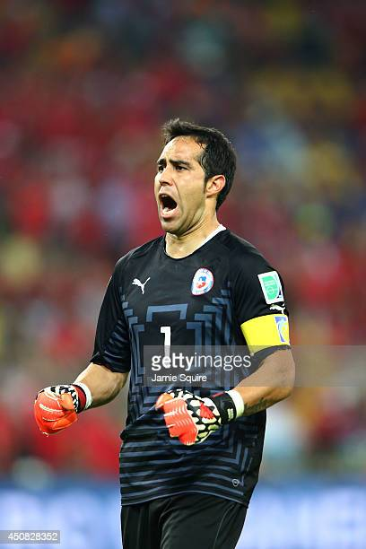 Claudio Bravo of Chile celebrates a 20 victory over Spain in the 2014 FIFA World Cup Brazil Group B match between Spain and Chile at Maracana on June...