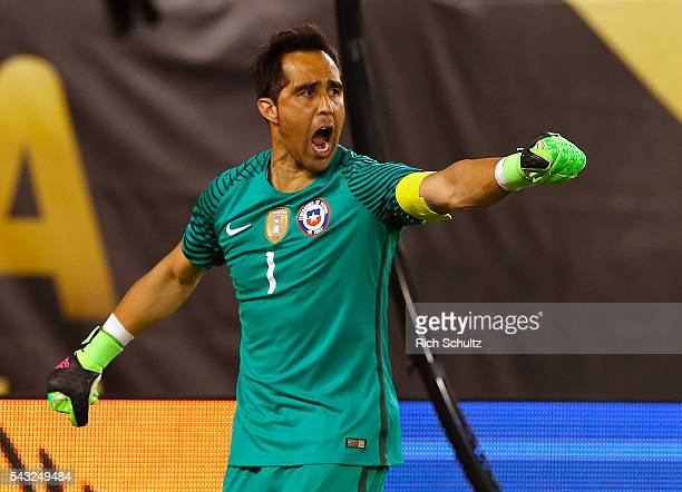 Claudio Bravo of Chile celebrates after saving a penalty shot by Lucas Biglia of Argentina during the championship match between Argentina and Chile...